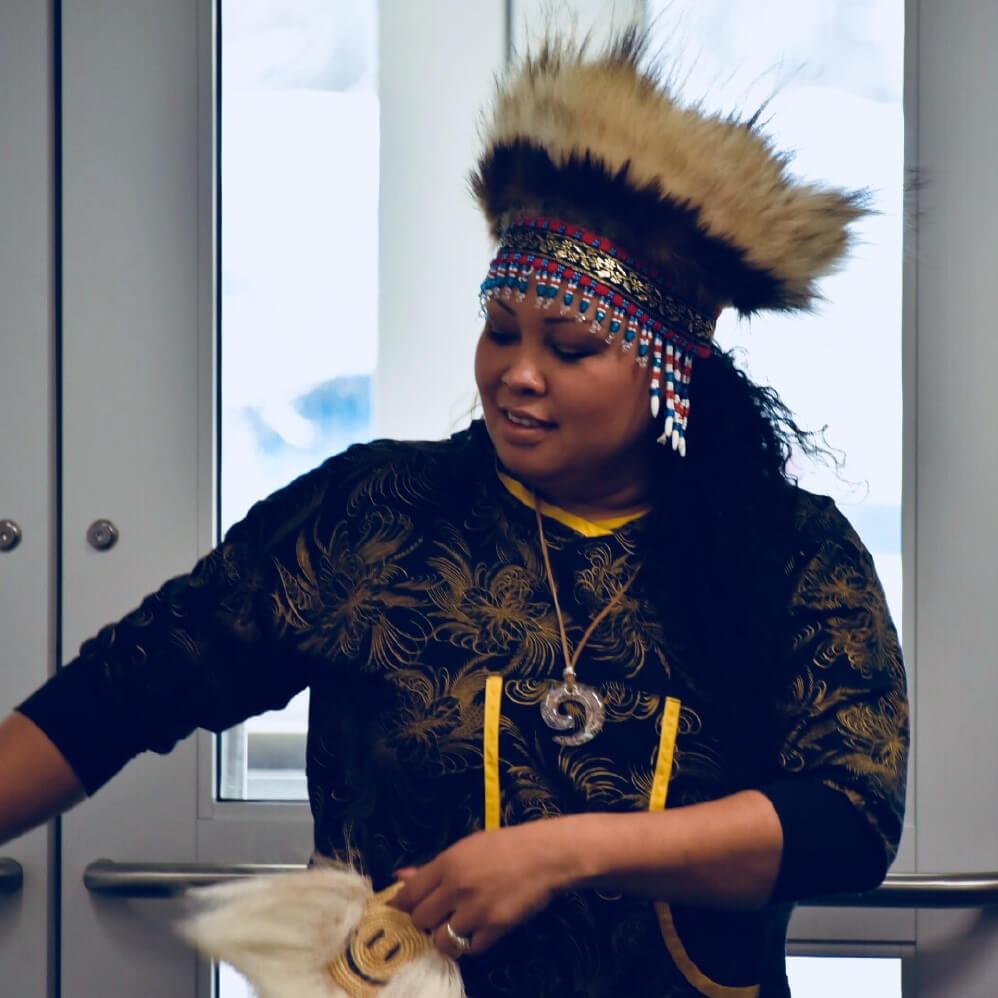 Native Alaskan woman performing a dance